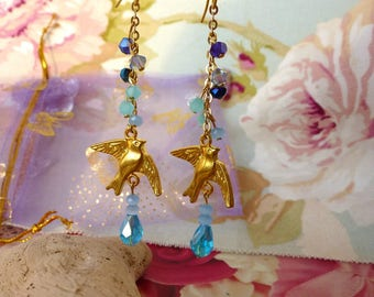 Swallow in the clouds - Crystal beads and swallow earrings.