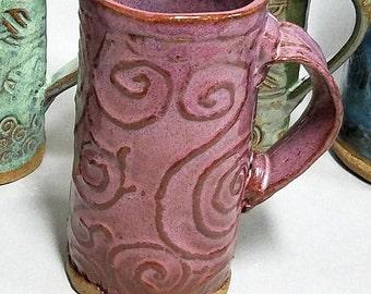 8+ ounce purple stoneware handle mug with celtic spiral designs
