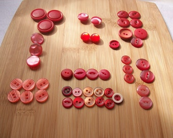 Mixed bag of red Vintage buttons