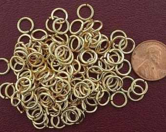 one hundred ten 8mm round gold plated jump rings