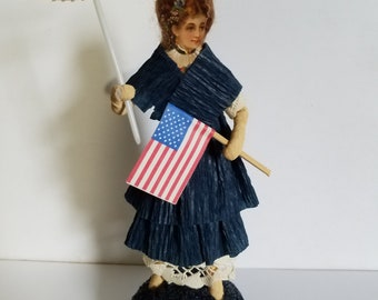 Spun Cotton Patriotic Woman with Parasol and Flag with Victorian Diecut face and Crepe Paper Dress