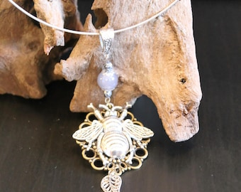 all on bronze filigree with insect necklace silver necklace, purple bead and silver leaf