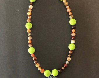 One of a kind hand crafted pendant on glass bead necklace.