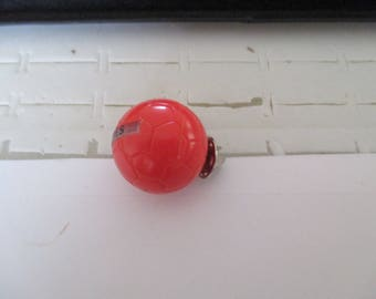 Red round soccer ball pins