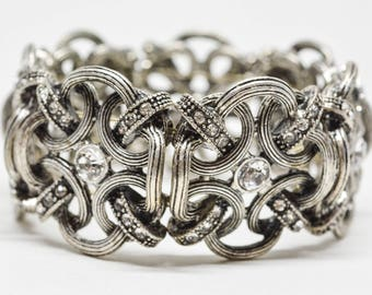 Large silver tone and crystals stretchable bracelet