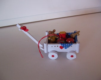 little white cart with tiny toys ornament