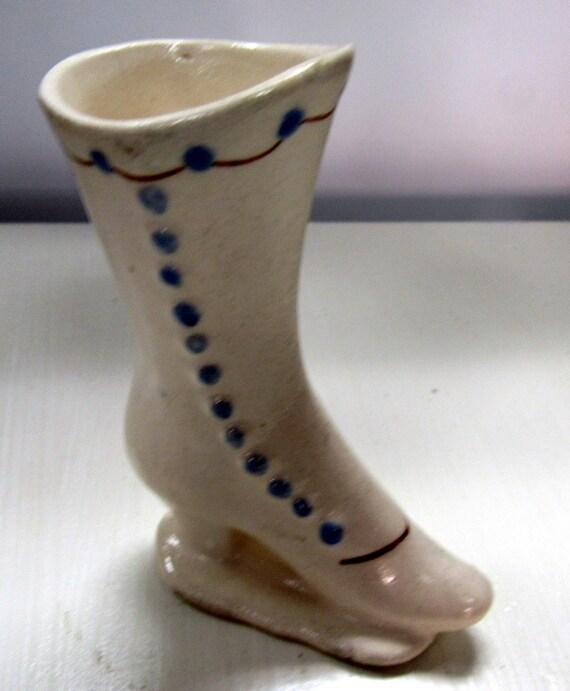 White ceramic miniature shoe