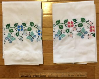 Cross-stitched floral pillowcases, set of 2