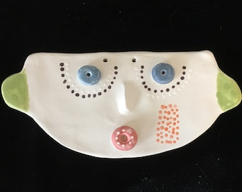 Mask in white earthenware and paint colors