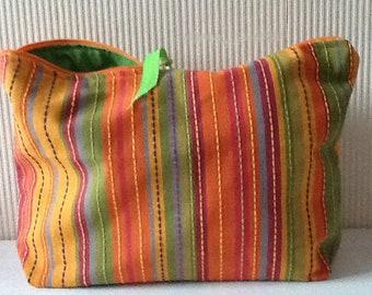 Clutch purse in orange and green striped cotton