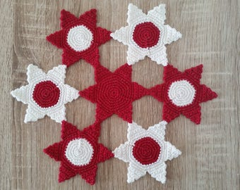 Below flat red and white doily, Christmas, glitter