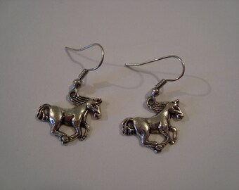 Silver metal galloping horse earrings