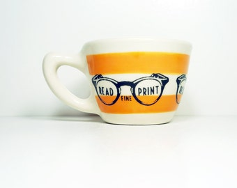 "12oz cup with a retro ""read the fine print"" print, shown here on creamsicle stripes - Made to Order / Pick Your Colour"