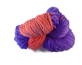 "Luxury hand dyed 4 ply merino - nylon sock yarn. Indie dyer. 100g. 400m. ""Joie de Vivre"". Purple, salmon pink"