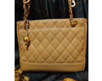 Vintage CHANEL Beige quilted caviarskin purse tote with the gold-tone ball and chain handles. Classic bag for the rest of your life