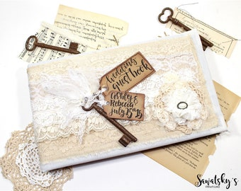 handmade lace wedding guest book with rusty key