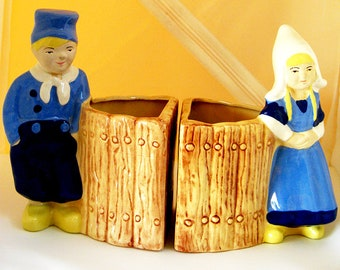 Pair of vintage hand painted Dutch Boy and Dutch Girl planter or bookend figurines from Stewart McCulloch Pottery of California