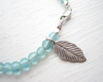 Sterling silver and glass bracelet, recycled glass bead, aqua glass bracelet, Hill Tribe silver, silver leaf charm, aqua bead bracelet