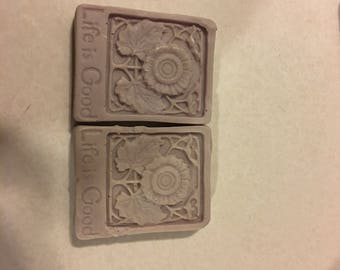 "2 pack Sweet pea scented, purple soaps, with ""Life is good"" imprint"