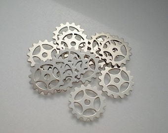 12 small nickel silver gear-sprocket charms/stampings