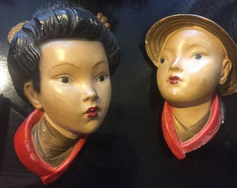 Vintage Art Deco style Chinese man and woman wall hangings  chalkware.