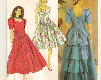 A Princess Seam, Sweetheart Neckline, Sleeveless/Short Sleeve, Back Ruffled Dress Pattern for Women: Uncut- Sizes 4-6-8-10 • Simplicity 7057
