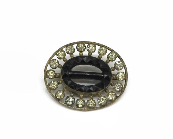 Vintage Art Deco buckle with clear rhinestones and black glass set in gold tone metal, circa 1930s