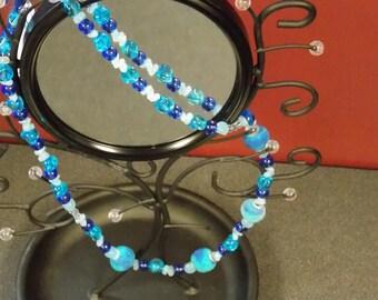 Long, various blues necklace