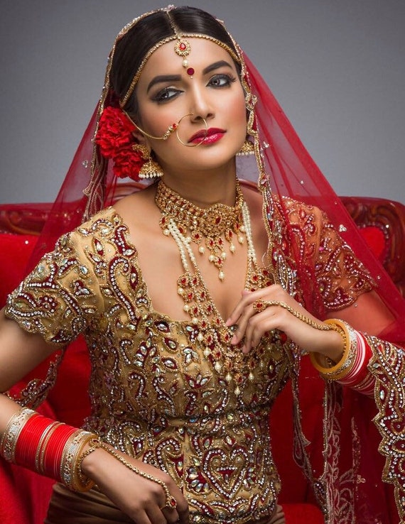 Sonia collection 8 piece Gold & red pearl traditional Indian bridal set