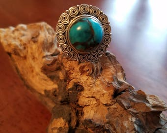 Sterling silver ring with blue turquoise. Aqua blue round stone with brown and gold marble.