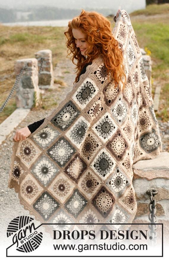 Bearbeitete Wolle und Alpaka mit Decke häkeln Quadrate