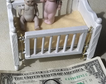 Two Antique Miniature Bisque Dolls, Japan and Germany in a newer Wooden Crib