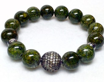 12mm Russian Jade with one 14mm Rhodium plated Micro Pave' CZ bead bracelet