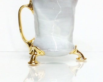 tall white mug with gold four finger handle