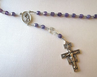 Franciscan Crown Rosary of Amethyst colored Glass with Saint Francis/ Saint Anthony Center and San Damiano Cross