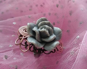 A bronze ring and Fimo flower