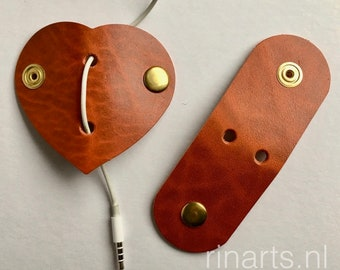 Earbuds holder / earphone / headphone cable organizers in rust orange vegetable tanned bridle leather. Cord organizer. Set of 2