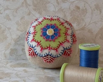 Handmade Pincushion Felted Wool Green, White, Blue and Red Flower on a Beige Pincushion