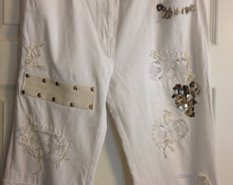 White Hippie Jeans by Simon Chang with Charms, Sequins, Lace, and Patches Ladies Size 10 Cotton and Polyester Previously 35 Dollars ON SALE
