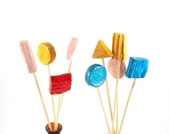 Colorful ceramic sticks, Modern ceramic, Vintage Pharmaceutical bottles, Ceramic spring  decoration. Rainbow color ceramics