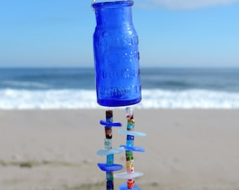 Cobalt blue vintage bottle beach decor with sea glass and beads