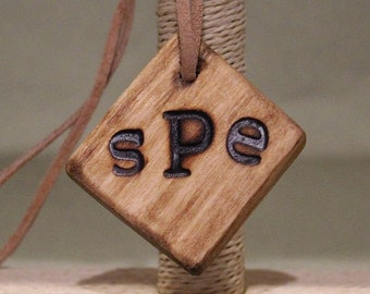 Wooden Diamond shaped Pendant with Lanyard Made from reclaimed wood.  Can be Monogrammed