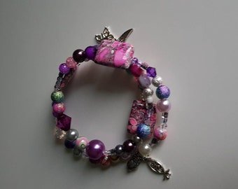 Memory wire boho style bracelet stack with charms and pink and purple beads