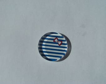 Cabochon 25 mm round and flat with its sailor look blue and white stripe with white rougeet bow, anchor