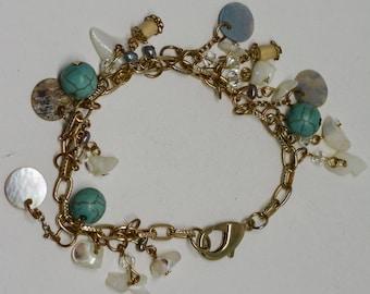 Lovely gold tone charm bracelet