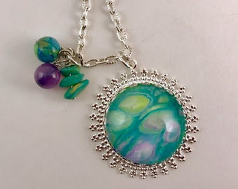 Teal/purple/green pendant and necklace in silver setting.