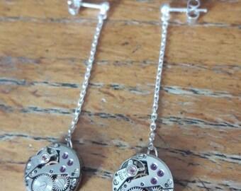 Dangling earrings in silver with LIP watch movements