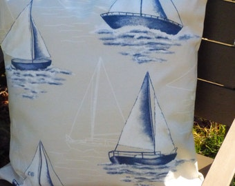 Yacht cushion cover for 50cm pad. Blue, white and beige sailing design front. Textured cotton canvas back with envelop closure.