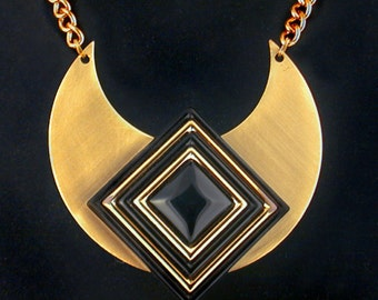 Dramatic black focal on satined crescent pendant