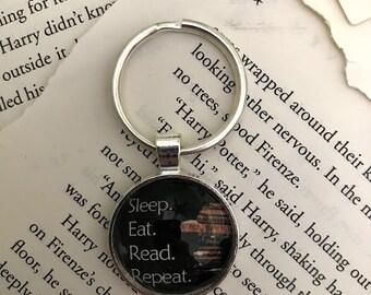 Eat, Sleep, Read, Repeat Pendant